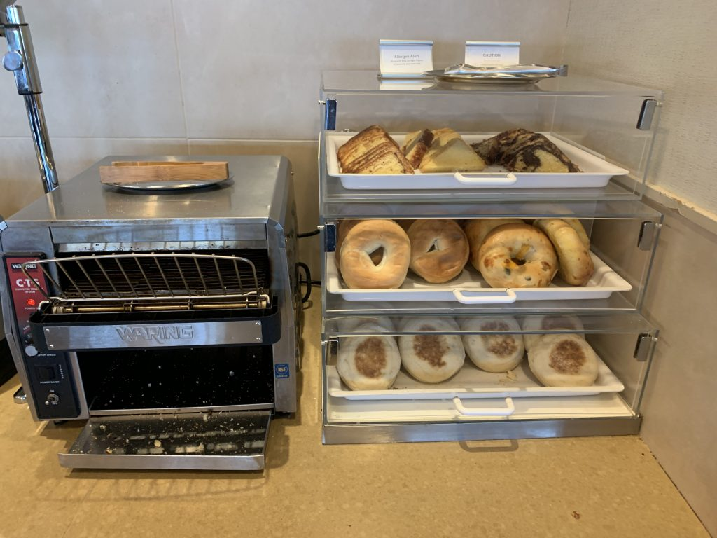 Toasting station including bagels, English muffins, and pound cake at the Admirals Club SFO.