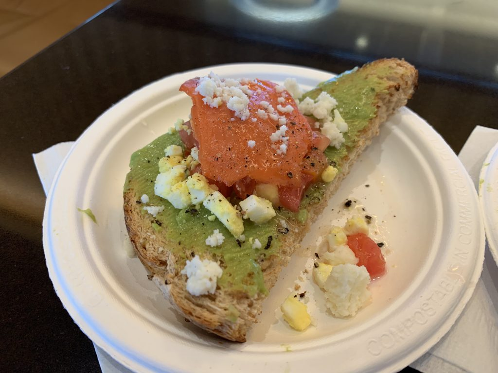 Avocado toast with smoked salmon, hard boiled egg, and feta cheese as provided by the Admirals Club lounge SFO.