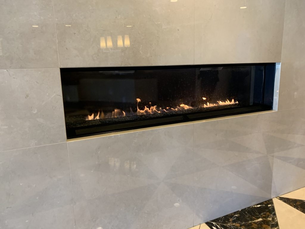 Gas burning fireplace at the American Airlines Admirals Club.