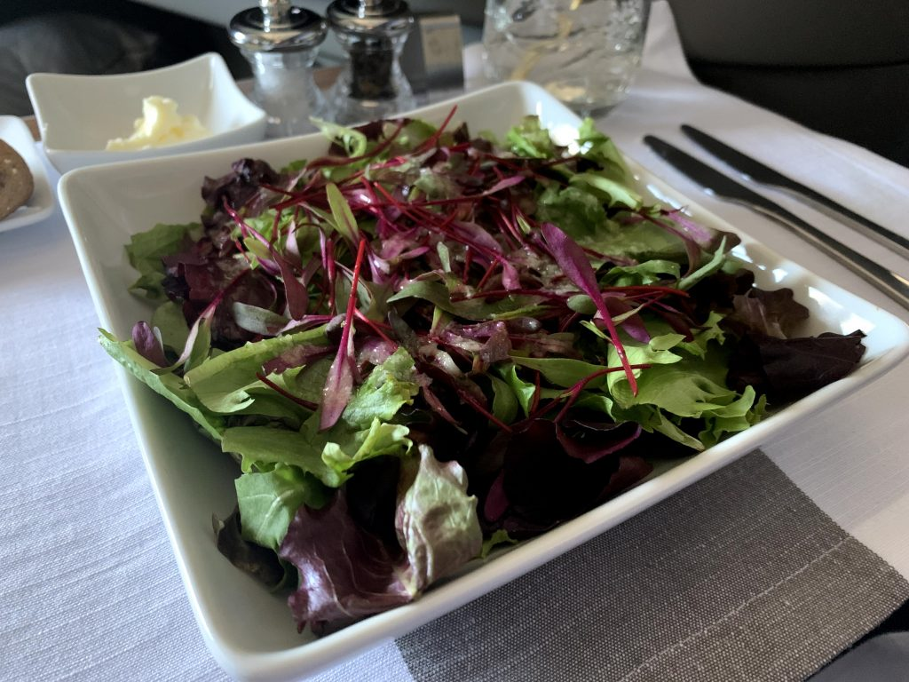 Sad-looking salad, a large bowl of greens, served on American Airlines First Class transcon routes.